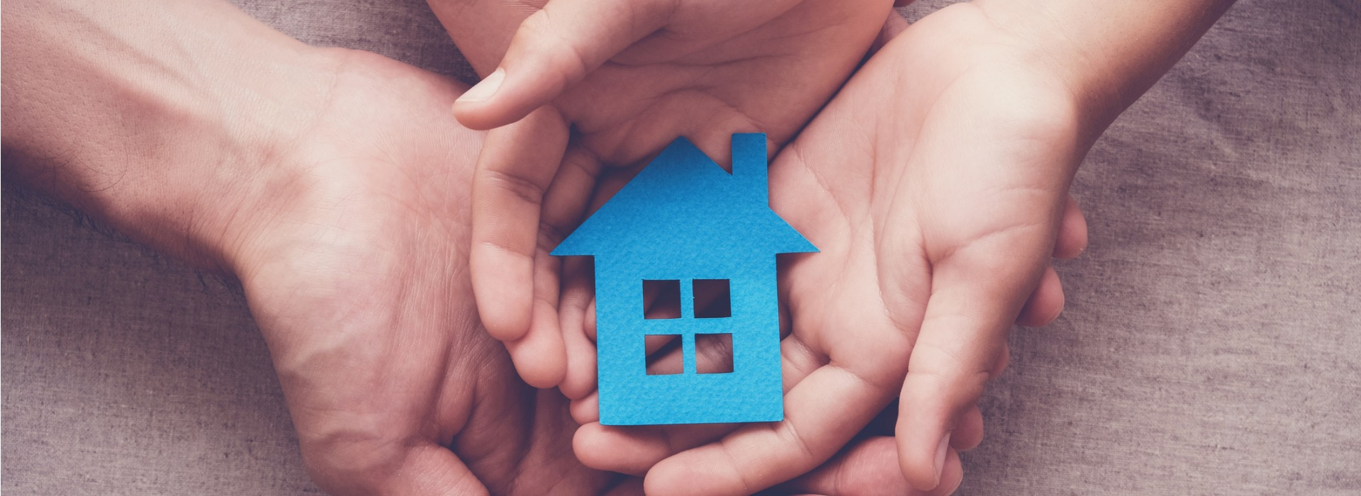 adult-and-child-hands-holding-paper-house-family-home-and-homeless-picture-id953686240.jpg